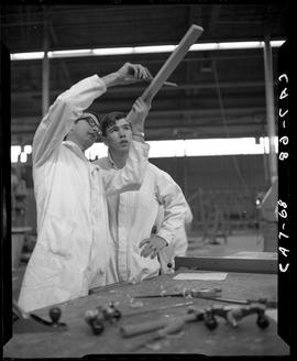B.C. Vocational School image of a Carpentry Trades instructor teaching a student at a bench in th...