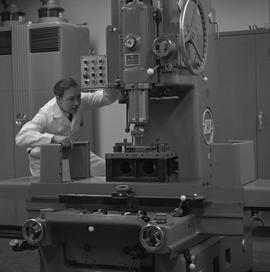 Mechanical technology, 1968; man in a lab coat using a drill [2 of 2]
