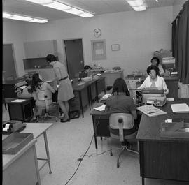 BC Vocational School Commercial Program; students typing ; student talking to instructor