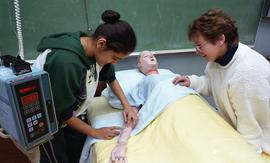 General Nursing, student with dummy patient in bed [7 of 8 photographs]