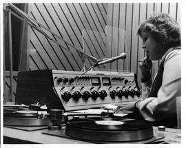 Women at turntable with microphone. BCIT Radio station CFML goes on air Friday, January 22, 1982