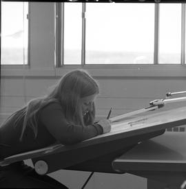 BC Vocational School drafting course ; female student sitting at a desk drafting a diagram