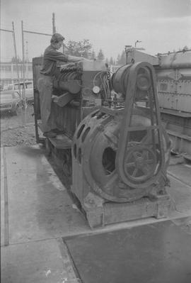 Pacific Vocational Institution ; trade student working on large machinery [2 of 3]