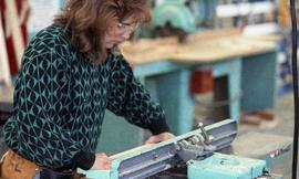 BCIT Women in Trades; carpentry, woman using bench tool (sander?) [5 of 5 photographs]
