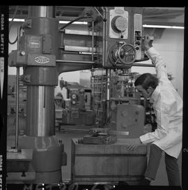 Mechanical technology, 1968; man in a lab coat using a large Asquith drill [2 of 3]