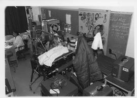 BCIT Broadcast Centre, storage room; woman sitting at a desk