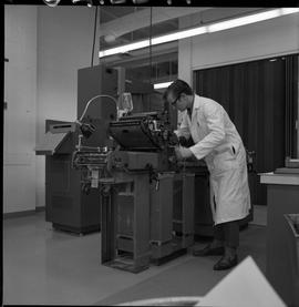 BCVS Graphic arts ; a man adjusting printing equipment