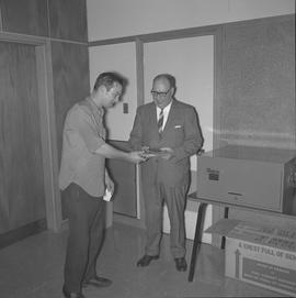 Heavy Duty presentation, 1970; student being awarded a plaque
