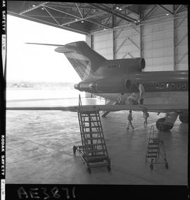 British Columbia Vocational School image of an Aeronautics instructor and students working on the...