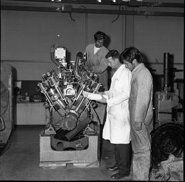 BCVS Heavy duty mechanic program ; an instructor and two students looking at engine cylinders