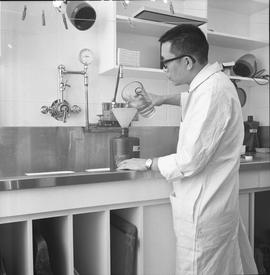 BCVS Graphic arts ; a man preparing darkroom chemicals [2 of 3]
