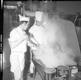 BC Vocational School Cook Training Course ; student frying onions ; instructor, Alois Marinschek,...