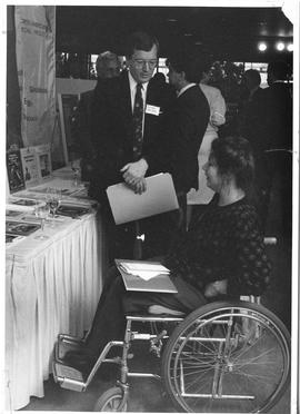 Alumni Association event, 1987; George Madden speaking with a woman in a wheelchair