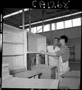 B.C. Vocational School; Carpentry Trades instructor and a student in the Carpentry shop using a s...