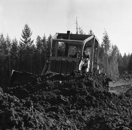 Heavy duty equipment operator, Nanaimo ; man operating a bulldozer moving dirt [7 of 9]
