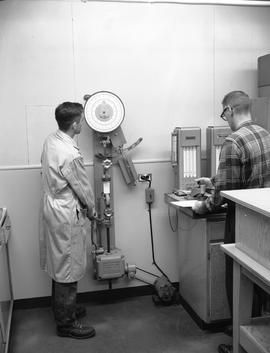 Forest Products, 1964; two men using forest products testing machinery [1 of 2]