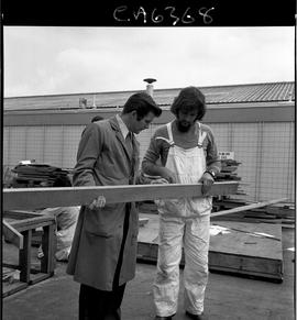 B.C. Vocational School; Carpentry Trades instructor and student examining a two-by-four in the Ca...