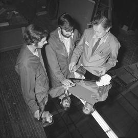 BCVS Glazier program ; three men looking at a piece of glass [2 of 2]