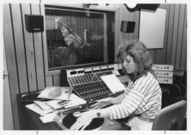Broadcast Communication; two women working in the on-air radio control booth