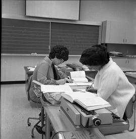 BC Vocational School Commercial Program; students in a classroom using shorthand to record inform...