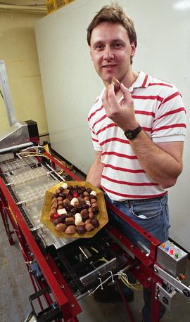 Gordon Thiessen, Chocolate Factory for Technology Centre, man posing with machine, chocolates [2 ...