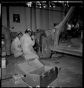 BC Vocational School image of Autobody program students working on a vehicle in the shop [1 of 8 ...