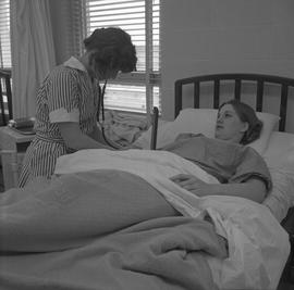Practical nursing, Nanaimo, 1968; nurse checking a patient's blood pressure