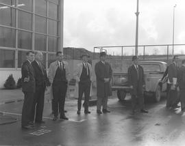 Forestry visit for Mr. Roper at BCIT on December 10, 1965; a group of men standing in a parking lot