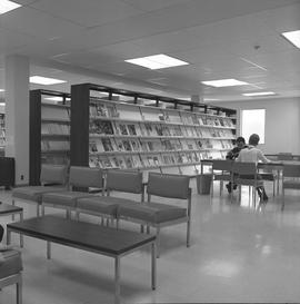 BCIT Burnaby campus library ; periodical shelves ; two people sitting at a desk [2 of 2]