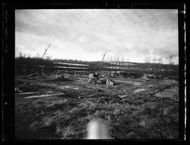 Construction of BCIT in progress, grass field, cranes