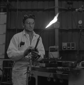 Welding, 1968; man turning on a welding torch [2 of 2]