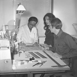BCVS Graphic arts ; three people at a desk looking at illustrations [11 of 11]