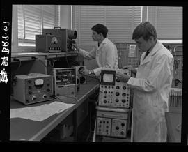 Two men in BCIT lab coats working