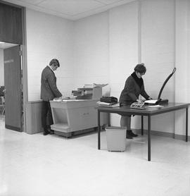 BCIT Library ; student using a photocopier ; student using a hole punch
