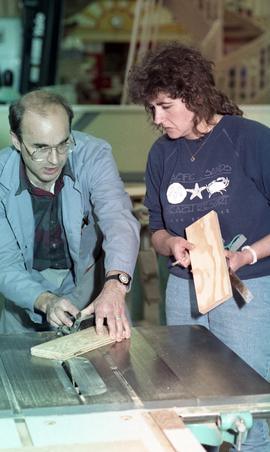 BCIT Women in Trades; carpentry, two people marking and measuring a piece of wood [2 of 6 photogr...