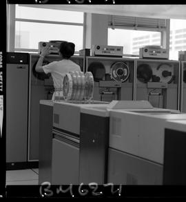 BCIT Business Management image of a women starting up a computer, IBM 3420, magnetic tape drive