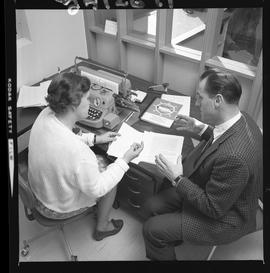 BCVS Graphic arts ; two people sitting at a desk and looking at paperwork [4 of 4]