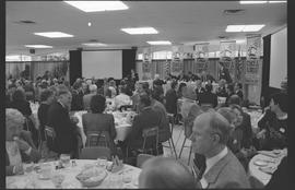 Groups of people at tables listening to speeches during Science and Technology week (October 14-2...