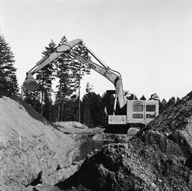 Heavy duty equipment operator, Nanaimo ; side view of an Insley excavator scooping dirt