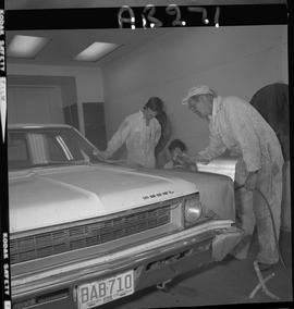 BC Vocational School image of Autobody program students repairing a vehicle in the shop [1 of 2 p...