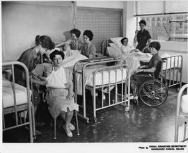 Hospital setting, scene with nurses, patients, patient dummy and wheelchair