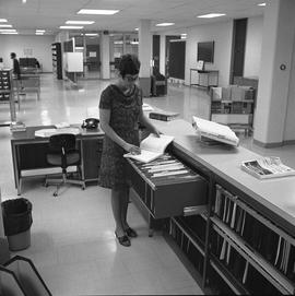 BCIT Burnaby campus library ; staff member looking through files