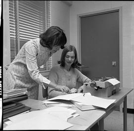 BC Vocational School Commercial Program; instructor and student looking at a book
