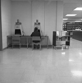 BCIT Burnaby campus library ; man looking at a microfilm reader