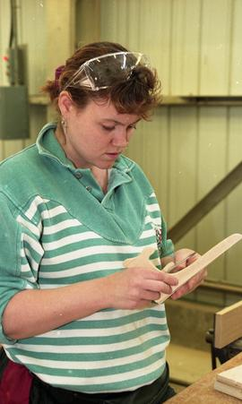 Trades discovery for women; carpentry, students using carpentry tools and equipment inside a shop...
