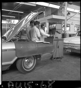 B.C. Vocational School image of an Instructor and Automotive program students working on a vehicl...