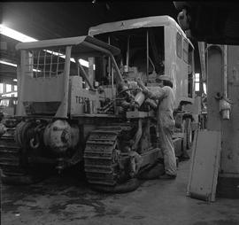 BCVS Heavy duty mechanic program ; two men working on hydraulics on a tractor [2 of 2]