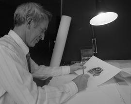 Computer Based Education (CBE), man working, looking at drawing
