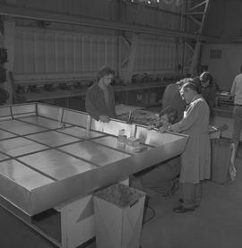 Sheet metal, 1968; instructor watching two students working on a project ; students working in ba...