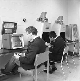 BCIT Library ; two students using microfilm readers [2 of 4]